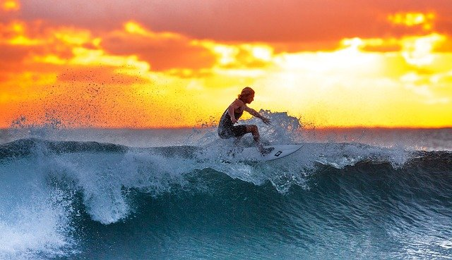 A Surfer In The Sunset